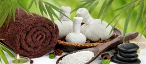 Spa massage border with towel, compress balls and bamboo
