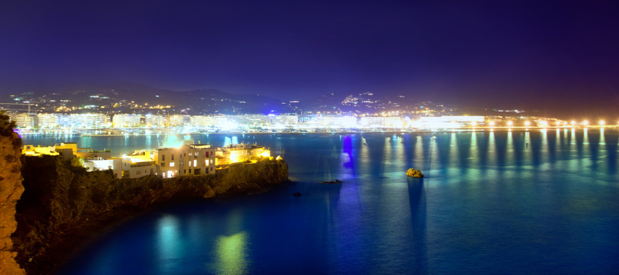 Ibiza town port blue sea night lights of Eivissa city