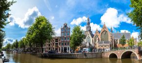 Oude Kerk (Old Church) and Voorburgwal canal in Amsterdam